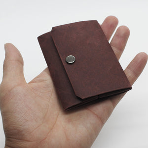 Slim, minimalist, eco-friendly paper wallets that help you live simply. Kamino Slim Coin Purse keeps your coins in the smallest profile.
