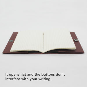 Kamino Notebook Cover opens flat and the buttons don't interfere with your writing.