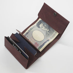 Slim, minimalist, eco-friendly paper wallets that lighten your load. Kamino wrap wallet holds cards, notes, and coins in the most minimal profile.