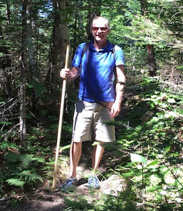 hiker with wooden staff