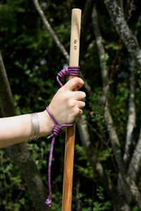 hiking with wooden stick and lanyard