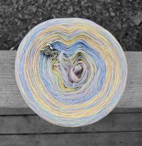 Pastel yellow, pink, purple, and blue variegated yarn