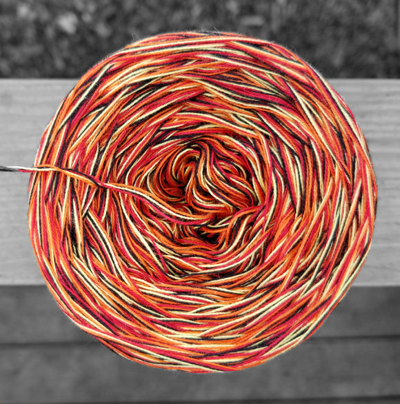 Black, red, yellow, and orange cotton variegated yarn.
