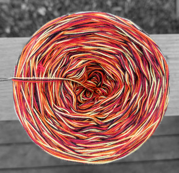 black, yellow, orange, red and burgundy variegated yarn