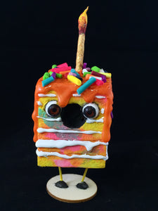 Rainbow Spun Cotton Cake figurine with Orange frosting