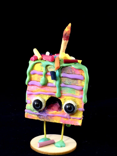 Rainbow Spun Cotton Cake figurine with green  frosting