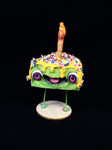 Green Spun Cotton Cake figurine with yellow frosting