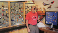 craftsman gary starr stands at a display case