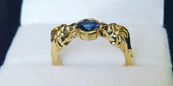 The Lion King yellow gold sapphire engagement ring