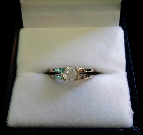 Split shank diamond solitaire with half bezel in box