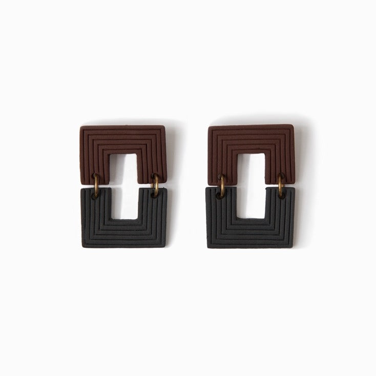 Brown and black handmade ceramic statement earrings.