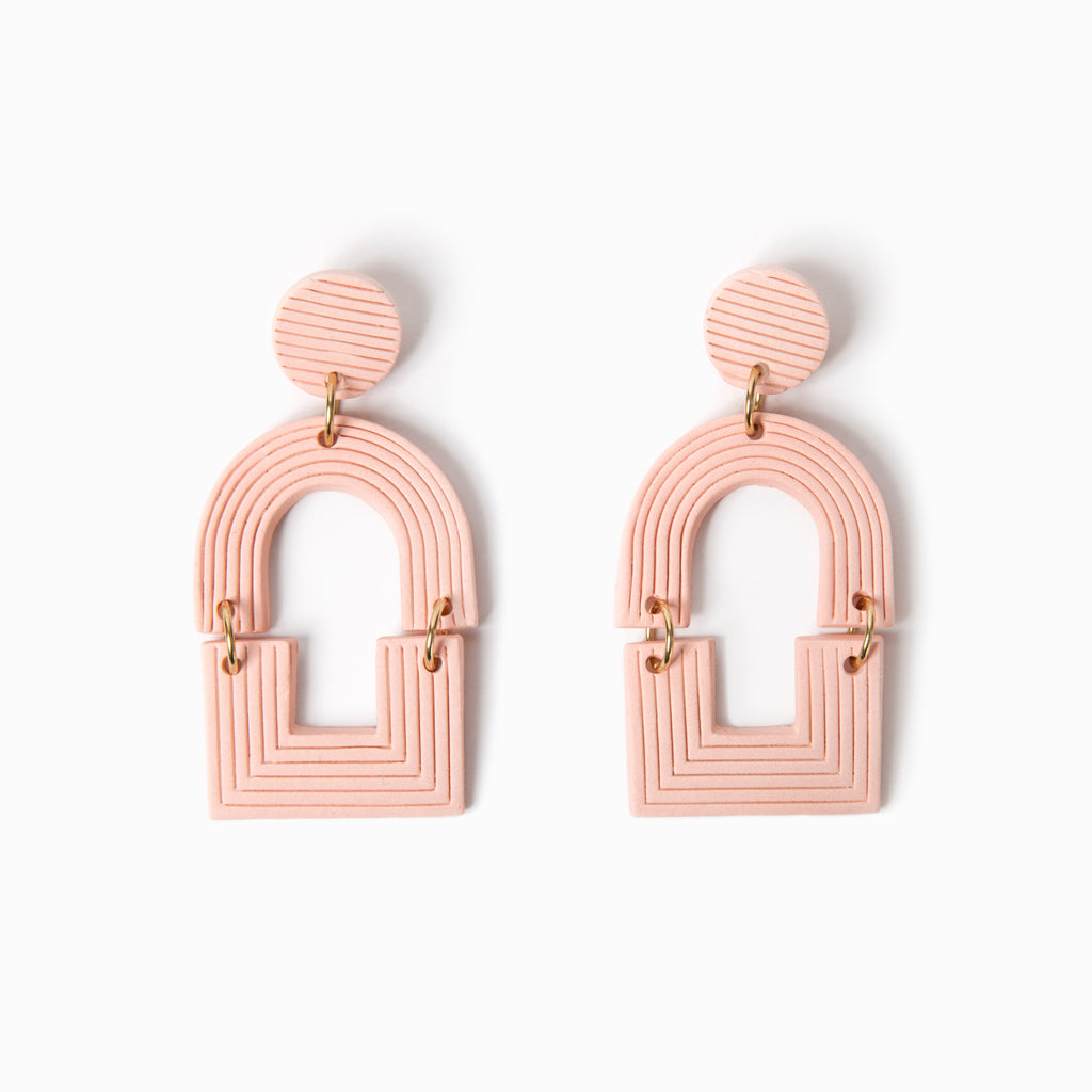 Peach handmade ceramic statement earrings.