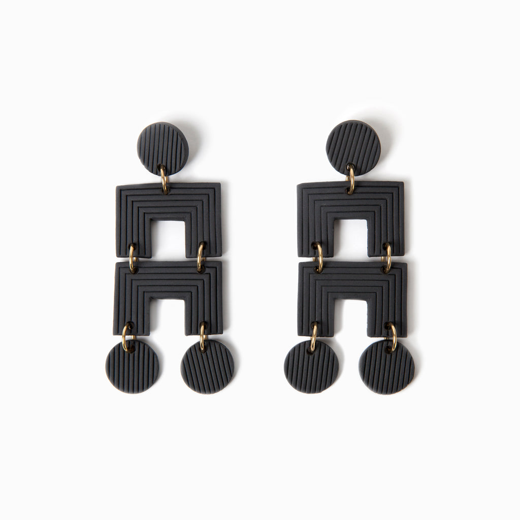 Black handmade ceramic statement earrings.