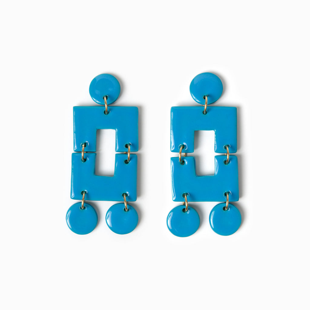 Turquoise blue handmade ceramic statement earrings.