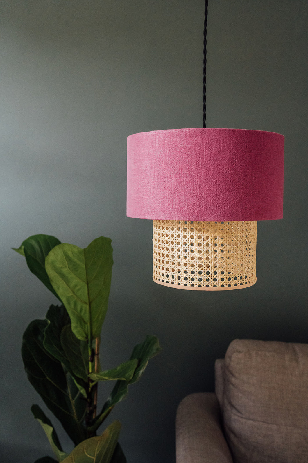 Two-tiered rattan and cerise linen lampshade