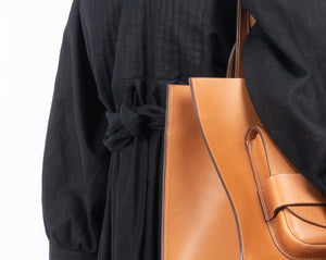 tan pioneer tote bag black linen dress quilted
