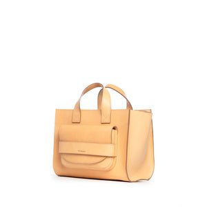 THE REGULAR light tan 'blonde' leather Pioneer Tote bag. Side front view showing large front pocket and grab handle detail.