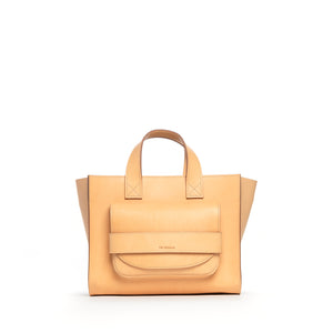 THE REGULAR light tan 'blonde' leather Pioneer Tote bag. Front view showing large front pocket and grab handle detail.