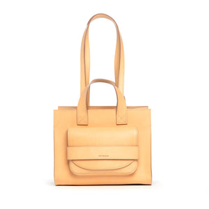 THE REGULAR light tan 'blonde' leather Pioneer Tote bag. Front view showing large front pocket and double handle detail.