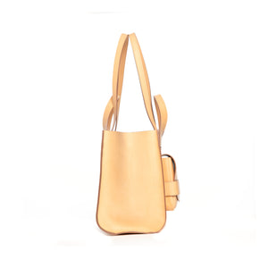 THE REGULAR blonde, leather Pioneer Tote.  Side view showing double handle.