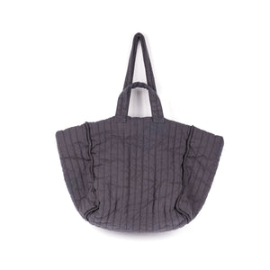 THE REGULAR Large Quilt Tote in grey garment dyed linen fabric.   Large quilted panels are bound together creating exposed seams. Bag also features double handle detail made up of shoulder length handles and smaller grab handles.