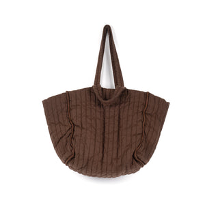 THE REGULAR Large Quilt Tote in bark brown, garment dyed linen fabric.   Large quilted panels are bound together creating exposed seams. Bag also features double handle detail made up of shoulder length handles and smaller grab handles.