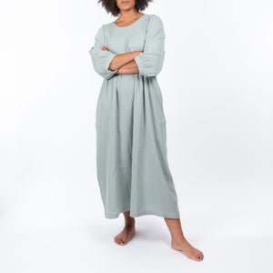 THE REGULAR Quilt Dress in eau de nil, light sage green cotton. Midi length, shown with puffed sleeves, quilted front bodice and belted at waist.