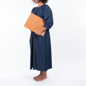 THE REGUALR tan, leather Folio doucument case worn with denim Quilt Dress.