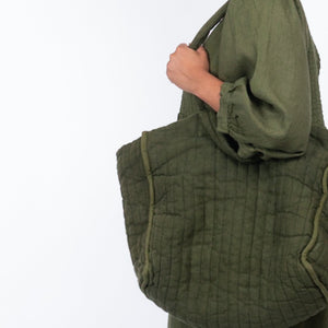 THE REGULAR Large Quilt Tote in olive green garment dyed linen fabric, worn shoulder tote style, with the Quilt Dress