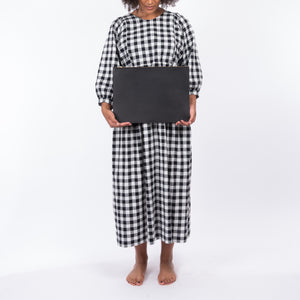 THE REGULAR black, leather folio doucument case worn with black and white gingham Quilt Dress