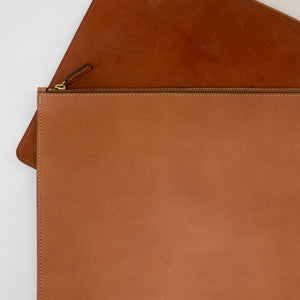 THE REGULAR tan, leather Folio showing how the patina and colour of the leather changes over time.