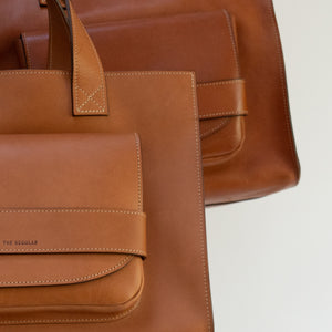 THE REGULAR Pioneer Tote bag in tan leather.  To show 'before and after' of how the leather patina will develop and change over time.