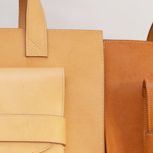 THE REGULAR light tan 'blonde' leather Pioneer Tote bag. 'Before and after' photo to show the change in patina over time.