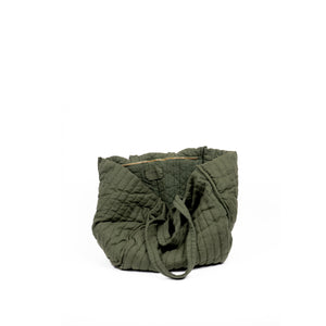 THE REGULAR Large Quilt Tote in olive green garment dyed linen fabric.   Large quilted panels are bound together creating exposed seams. Bag also features double handle detail made up of shoulder length handles and smaller grab handles.  Inside view shows large zip pocket.