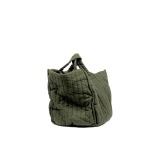 THE REGULAR Large Quilt Tote in olive green garment dyed linen fabric.   Large quilted panels are bound together creating exposed seams. Side view shows shorter grab handles.