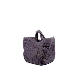 THE REGULAR Large Quilt Tote in grey garment dyed linen fabric.   Large quilted panels are bound together creating exposed seams. Bag also features a self fabric quilted grab handle.