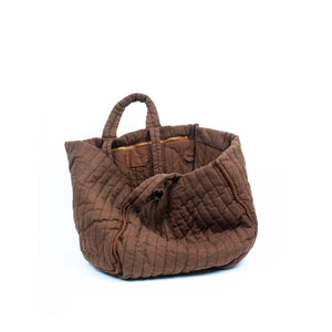 THE REGULAR Large Quilt Tote in bark brown, garment dyed linen fabric.   Inside view of bags shows quilted cotton lining, large zip pocket and D-ring detail. Large quilted panels are bound together creating exposed seams. Bag also features double handle detail made up of shoulder length handles and smaller grab handles.