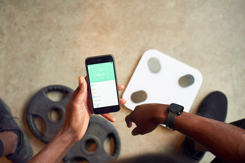 fittrack scale in gym with weights