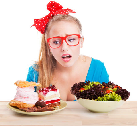 lady looking at cake and salad