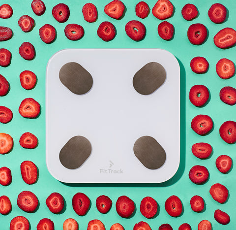 image of bmi scale surrounded by strawberries