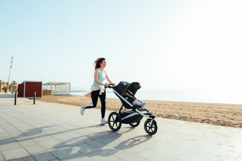 image of mother running with stroller