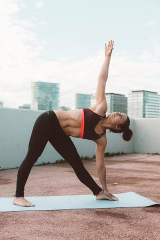 lady doing yoga on rooftop