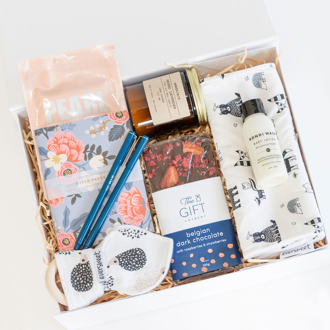 new-family-gift-box-Candle-+-pens-+-facemask-+-burp-cloth-+-teething-ring-+-chocolate