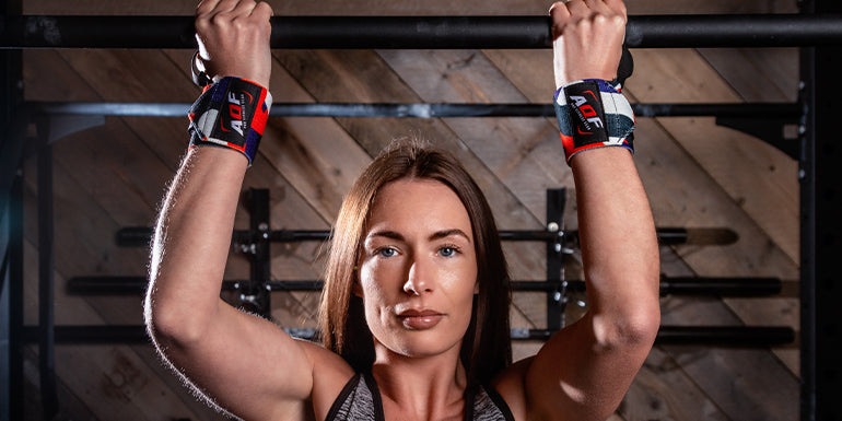 Fitness girl with the wrist wraps