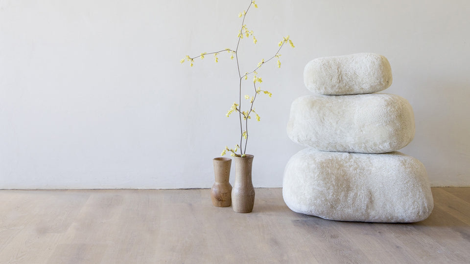 Sheepskin stones stacked up in minimalist interior space