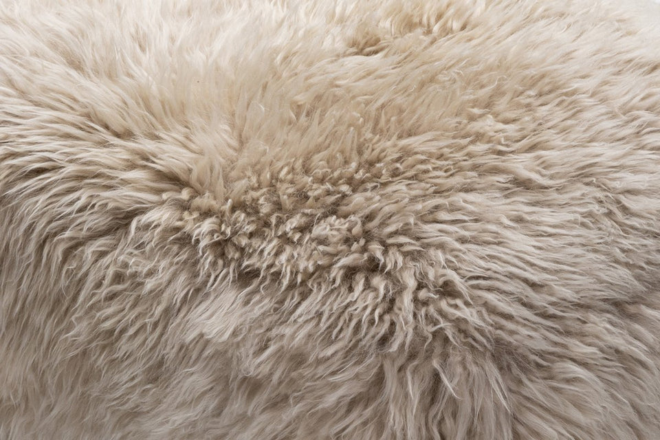 Closeup of a natural coloured long wool sheepskin rug