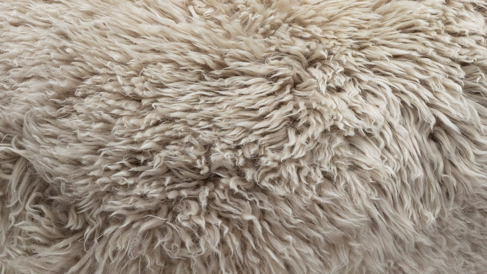Close up of natural coloured sheepskin rug