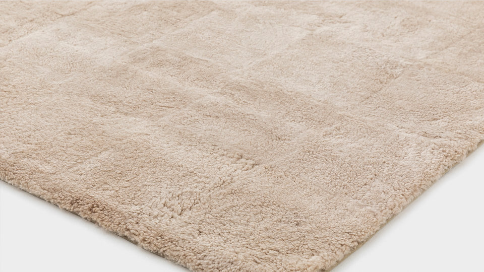 detail of a new zealand sheepskin wool floor rug