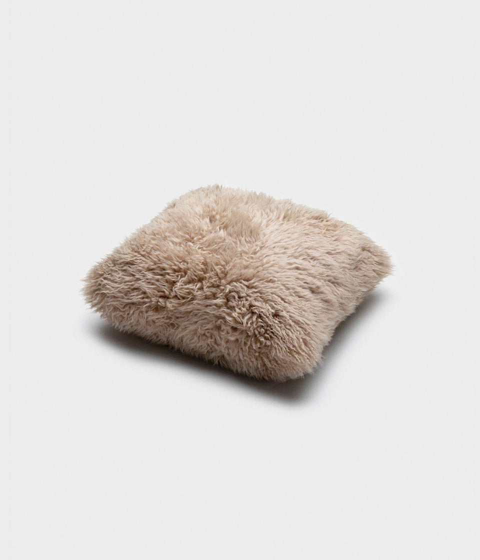 Neutral sheepskin cushion
