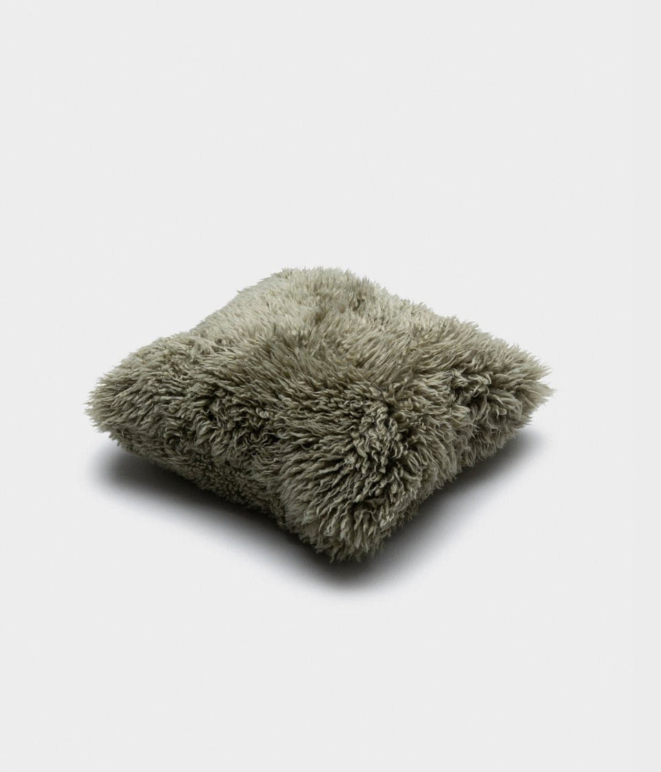 Green sheepskin cushion